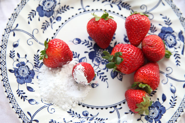 Fresh strawberries on plate Dessert Natural Light Snack Textures Close-up Colorful Day Decorative Food Food Porn Home Food Indoors  No People Overhead Plate Powdered Sugar Pretty Food Ready-to-eat Red Red White And Blue Seasonal Strawberries Studio Shot