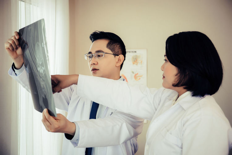 Doctors analyzing x-ray at hospital