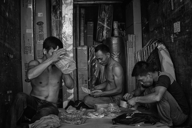 Daily Life Series, Manila. Casual Clothing Childhood Day Delivery Truck EyeEm Gallery Full Length Fun Innocence Labor Laboratory Leisure Activity Lifestyles Looking Lunch Mature Adult No Clothes  Person Sitting Workers