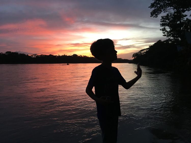 Sunsets Sunset Silhouettes Rio San Juan Sunset Water Real People Sky Silhouette Leisure Activity Lifestyles Beauty In Nature One Person Nature