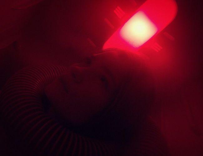 Portrait of boy sleeping in dark room