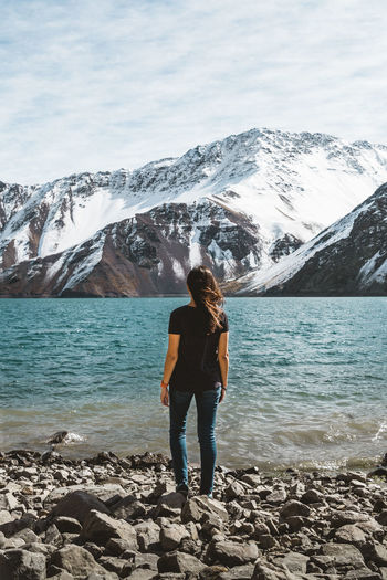 Lonely woman looking at the view in Chile Chile Embalse El Yeso Woman Beauty In Nature Brunette Cajon Del Maipo Lake View Lonely Woman Looking At View Mountain Range Mountains One Person Outdoors Real People Rock Rock - Object Snow Snowcapped Mountain Snowy Morning Snowy Mountains Standing Stone - Object Water Woman Portrait Young Adult The Traveler - 2018 EyeEm Awards It's About The Journey