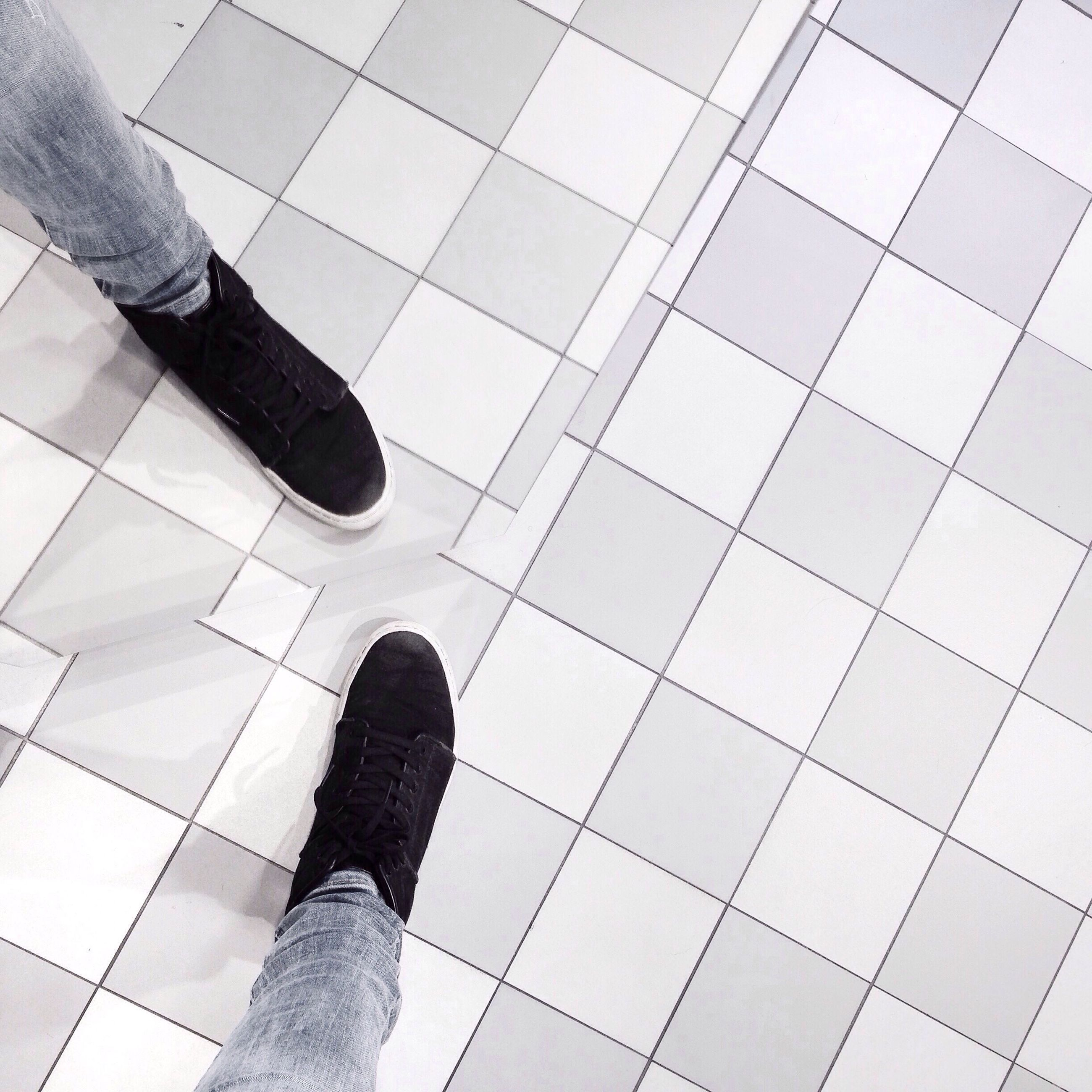 low section, person, shoe, high angle view, modern, low angle view, personal perspective, tiled floor, part of, reflection, lifestyles, standing, men, unrecognizable person, human foot, pattern, flooring