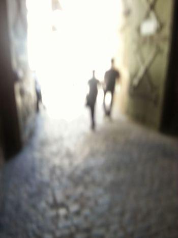 Street Defocused Walking City Silhouette Desaturated Blurry Light Walking By Doors Castle Walking Hand In Hand Holding Hands Heaven Heavenly Gates