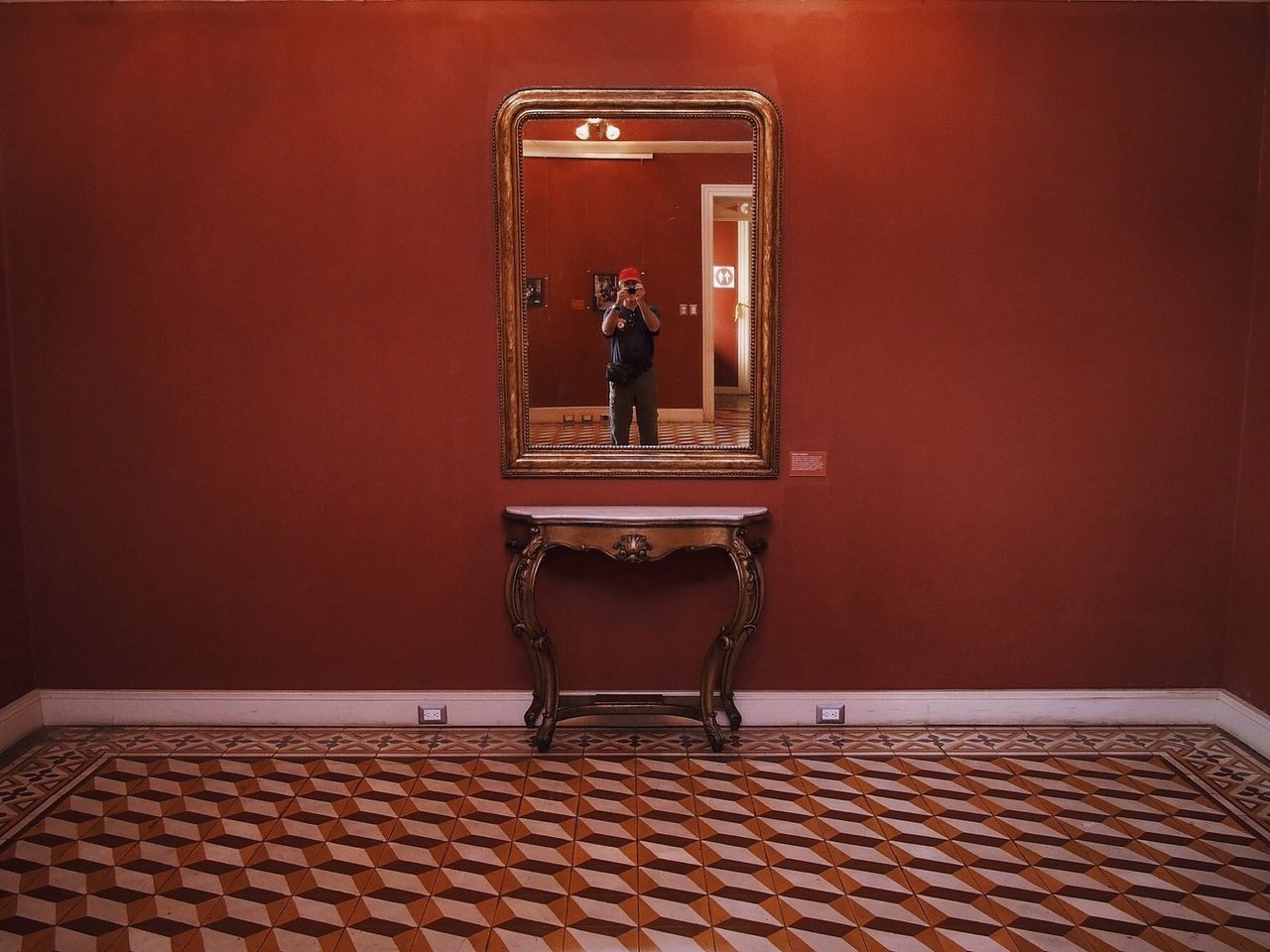 Reflection of boy making photo in mirror