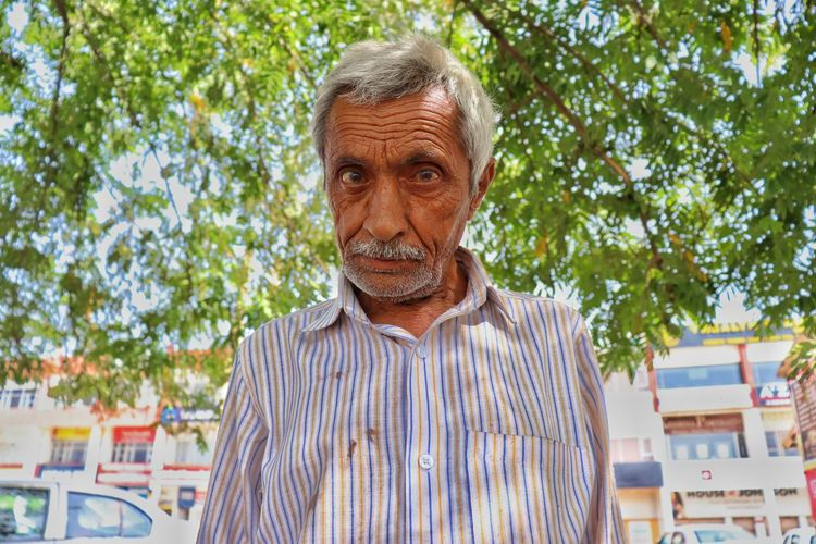 indian old man #NotYourCliche Front View Striped Balding One Senior Man Only One Mature Man Only Working Seniors Gray Hair Only Mature Men White Hair Retirement Community Only Senior Men Thoughtful Hair Loss Posing
