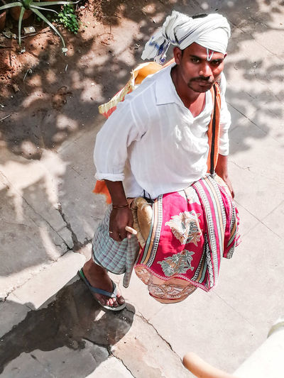 High angle portrait of man playing drum outdoors