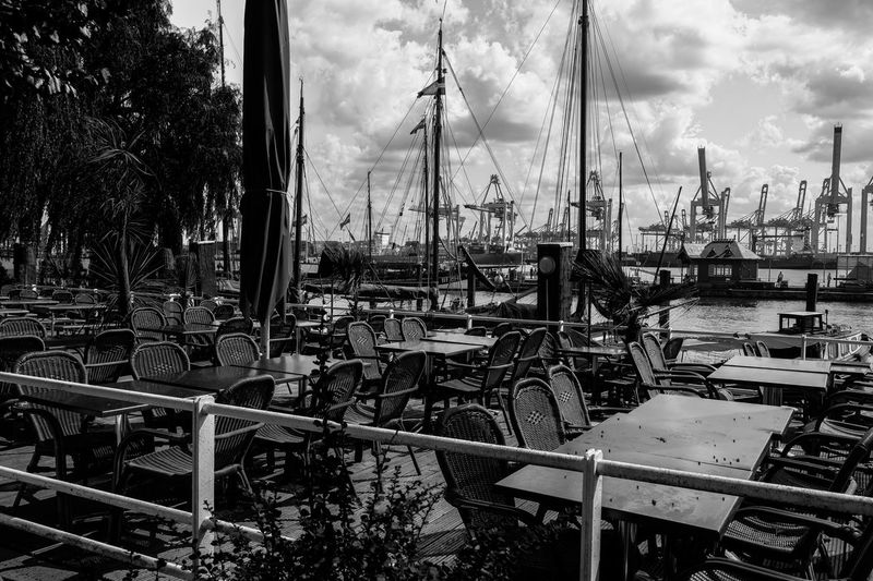 Moored Nautical Vessel Transportation Mast Sky Cloud Mode Of Transport Sailboat Day No People Harbor Group Of Objects Cloud - Sky Large Group Of Objects Marina Tranquility Cafe