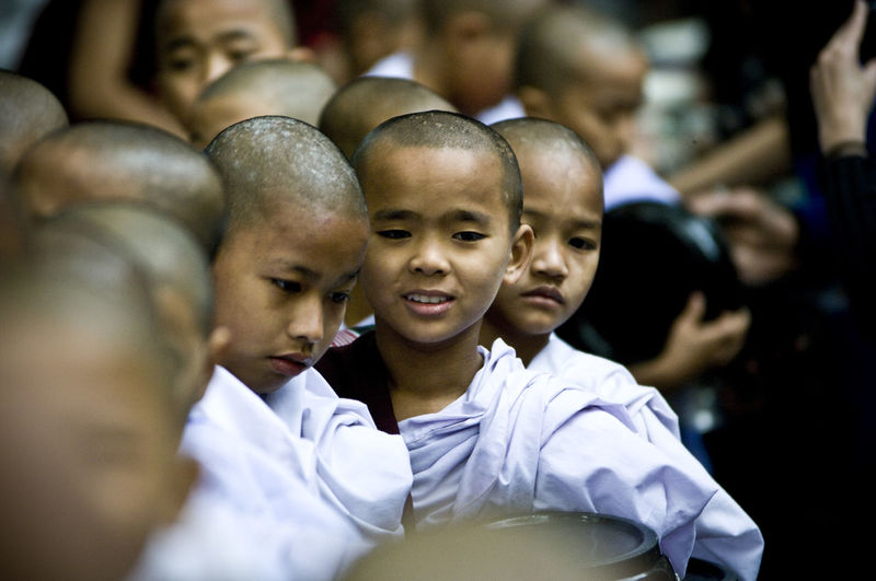Buddha Buddhism Buddhist Temple Burma Childhood Day EyeEm Best Shots EyeEm Gallery Family With One Child Focus On Foreground Front View Happiness Headshot Innocence Looking At Camera Monks Myanmar Peace Person Selective Focus Spirituality Tranquility Travel Photography