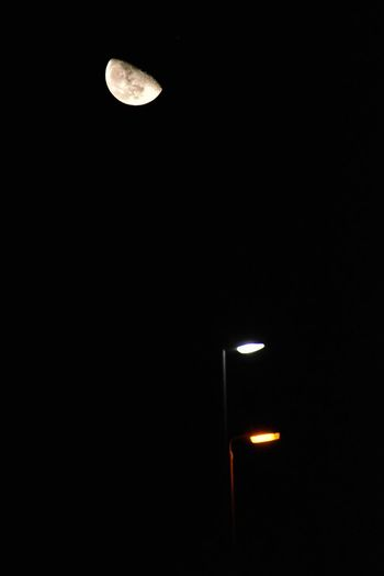 Low angle view of illuminated moon against sky at night