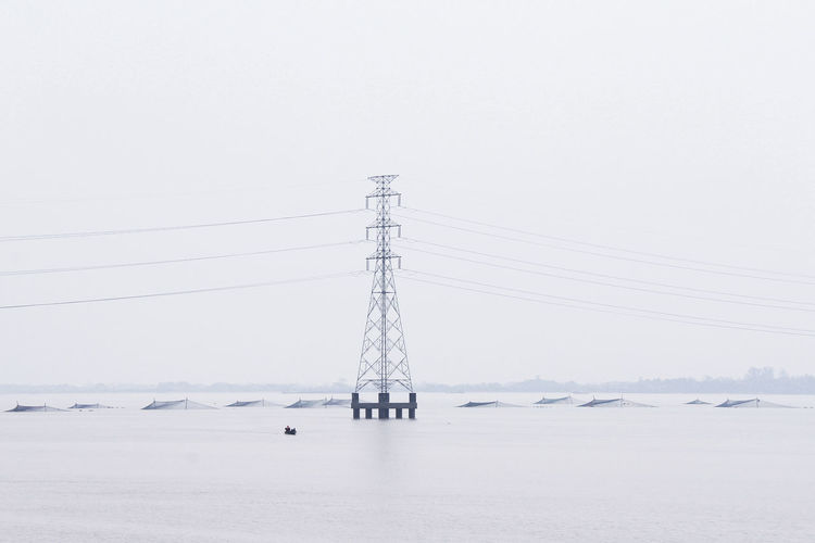 Environment Water Nature Copy Space Electricity  Sky No People Scenics - Nature Landscape Technology Land Business Finance And Industry Electricity Pylon Day Non-urban Scene Connection Winter Fog Beauty In Nature Outdoors Yangon, Myanmar The Traveler - 2019 EyeEm Awards