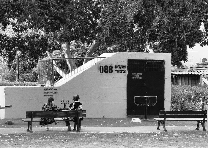 Tel Aviv Two old women are sitting in front of an atomic shelter in Israel Rehovot Atomic Shelter Israel People Public Garden With Shelter Shelter Sitting Two Women In Front Of A Shelter War