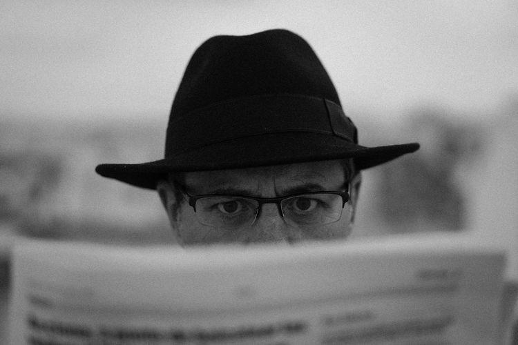 Close-Up Of Man Reading Newspaper