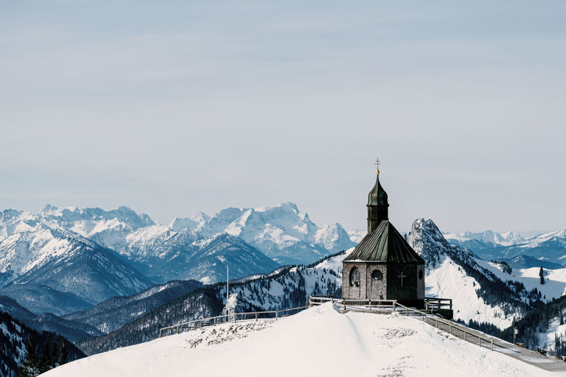 High angle view of old church against mountain view during winter