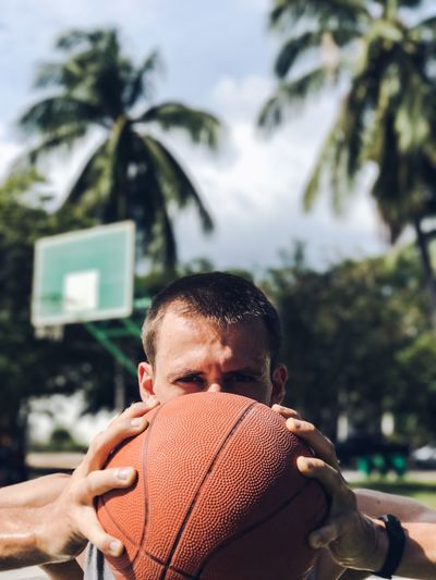 Ball Basketball - Sport Basketball Court Basketball Player Close-up Front View Headshot Healthy Lifestyle Holding One Man Only Be. Ready. Outdoor Activity Outdoors Palm Tree People Playing Sport Sports Sportsman Tree Young Adult Fresh on Market 2017