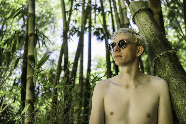 Tree Plant Shirtless Fashion Sunglasses One Person Glasses Real People Portrait Young Adult Leisure Activity Day Nature Forest Land Lifestyles Front View Looking Away Looking Outdoors Hairstyle