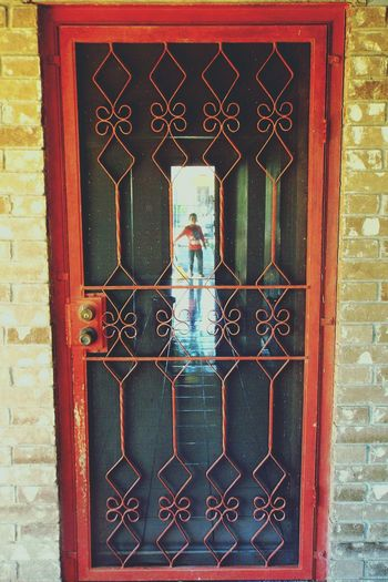 Red Door Old House Moving Out Childhood Home Child Doors Last Day Metal Door Boy At Door Boy Childhood Memories Empty House Reflection Childhood Tile Reflection Telling Stories Differently Home Is Where The Art Is Place Of Heart Breathing Space This Is Family