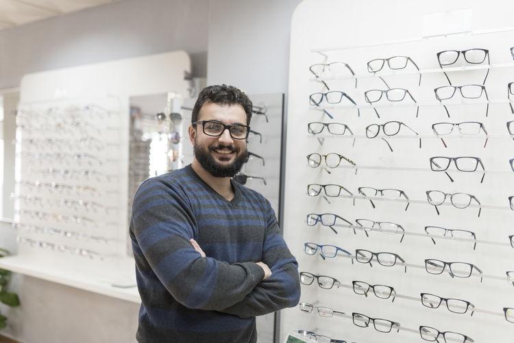 Portrait smiling man looking eyeglasses in store