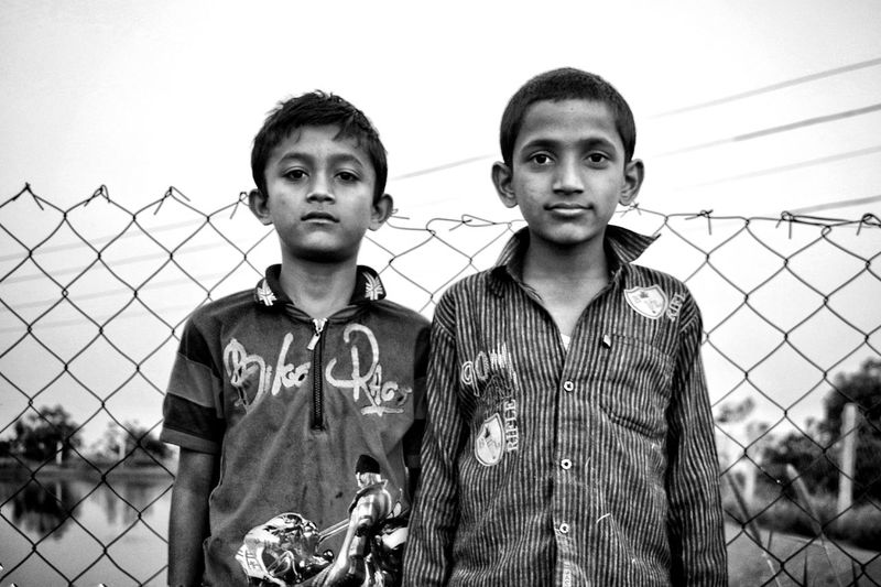 EyeEm EyeEm Best Shots EyeEmNewHere EyeEmSelect Popular TRENDING  Travel Only Adults Travelphotography Boys Portraits Conceptual Sunset_collection Portrait Photography Travel Photography Portrait Togetherness Looking At Camera Standing Chainlink Fence Sky Barbed Wire This Is Family