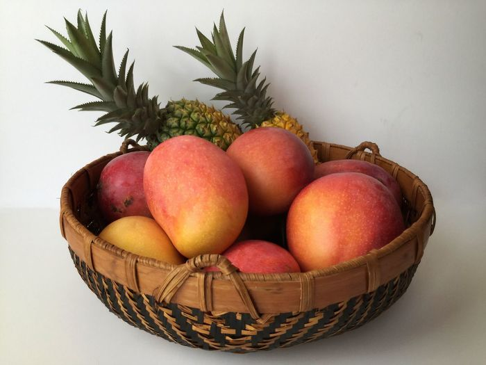 Fruit still life Mangoes Pineapples Fruit Still Life Florida Fruit Ripe Fruit Woven Baskets Fruit Basket Wood Basket