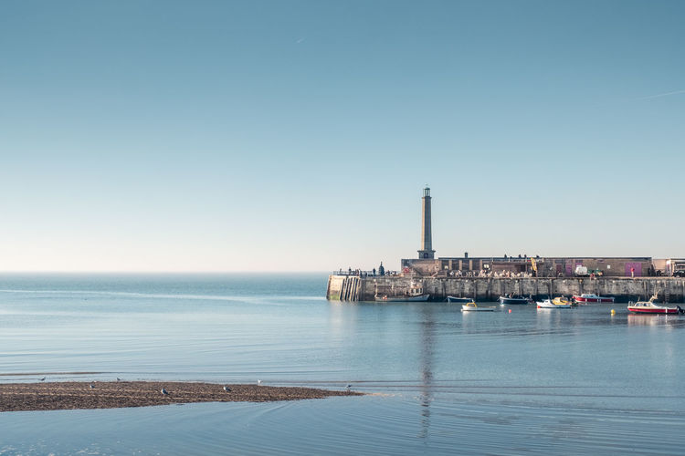 Margate Kent UK Margate Kent Harbour Harbour Arm Blue Sky Sea Water Architecture Built Structure Copy Space Building Exterior Tower Waterfront Outdoors Day Nature Beach Clear Sky Calm Tranquil Scene Beauty In Nature