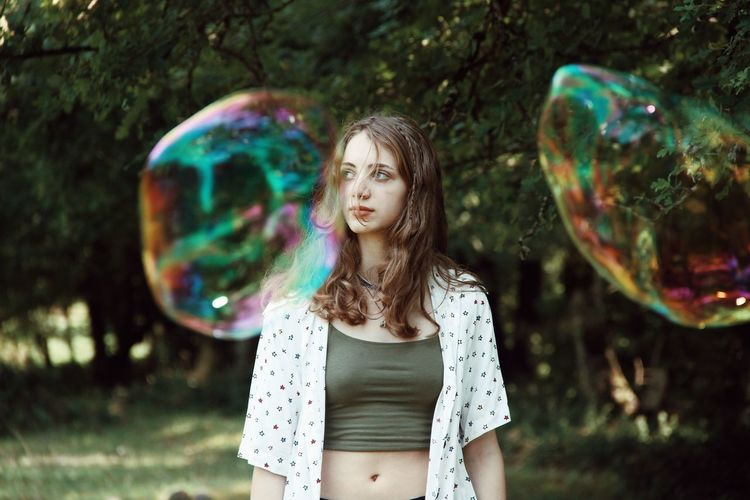 Full length of a beautiful young woman with bubbles