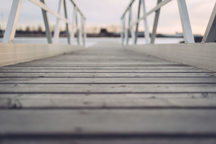 Close-up of wooden jetty against sky