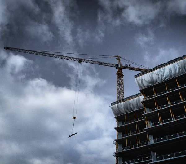 Architecture Built Structure City City Development City Life Cloud - Sky Construction Construction Site Crane Crane - Construction Machinery Day Development Enjoying Life Expansion Growth Low Angle View No People Outdoors Sky Storm