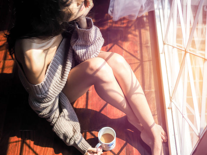 High angle view of woman sitting in balcony