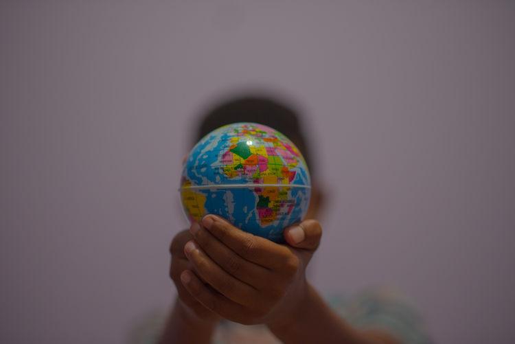 Close-up of boy holding globe