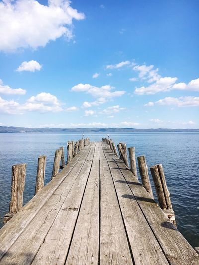 Sea Water Horizon Over Water Sky Beauty In Nature Nature Tranquil Scene Pier Tranquility Boardwalk Wood - Material Scenics Blue Idyllic Beach Cloud - Sky Day Outdoors No People