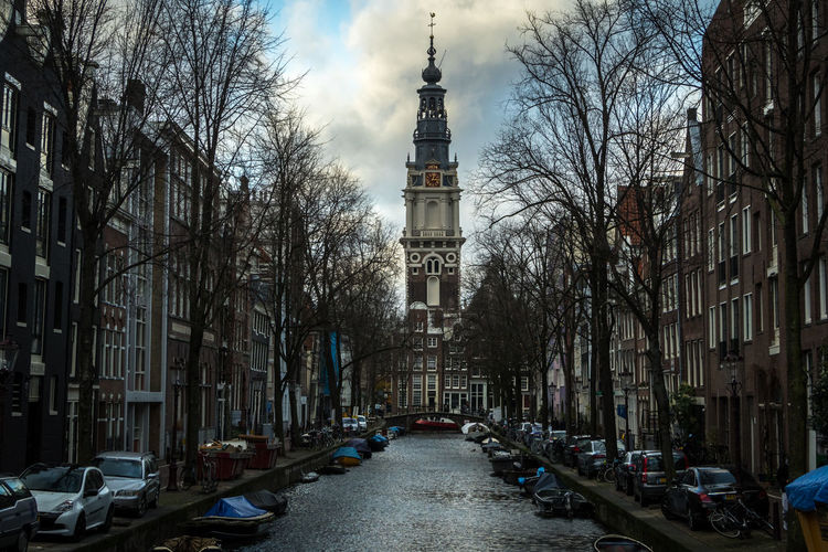 Amsterdam, The Netherlands Amsterdam The Netherlands Nederland Architecture Building Exterior Built Structure Building City Transportation Outdoors Mode Of Transportation Motor Vehicle Car Tree Bare Tree The Way Forward Land Vehicle Tower Street Religion Place Of Worship Sky Belief No People Church