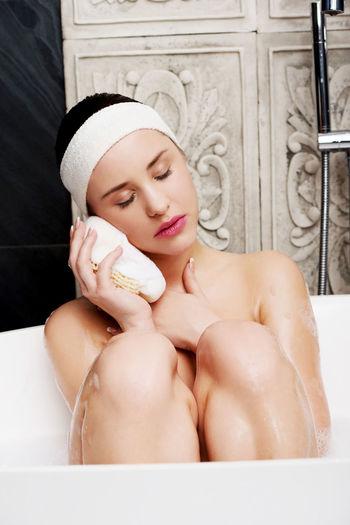 Woman Taking Bath In Tub