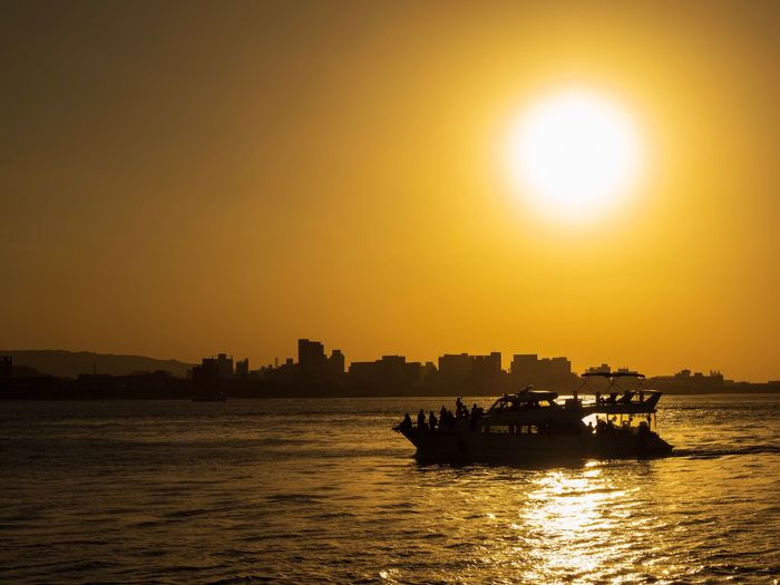 Sunset Riverview River River Sky Sunset Nautical Vessel Transportation Sun Mode Of Transportation Sea Sunlight Silhouette Waterfront Reflection Architecture Scenics - Nature Building Exterior Nature Outdoors Orange Color City Beauty In Nature