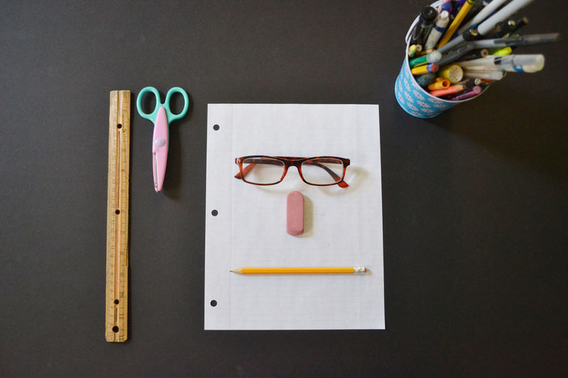 Stationery Paper Face Pencil Pen Scissors Glasses Desks From Above Eraser Desk School Crayons EyeEm Bestsellers