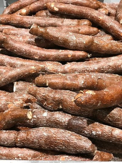 Manioc Diet Glutenfree Gluten Free Root Root Vegetable Manioc EyeEm Selects Full Frame Backgrounds Brown Pattern No People Close-up Still Life Sunlight Food And Drink Food Large Group Of Objects Day For Sale Abundance Textured  High Angle View Freshness Nature Stack Outdoors