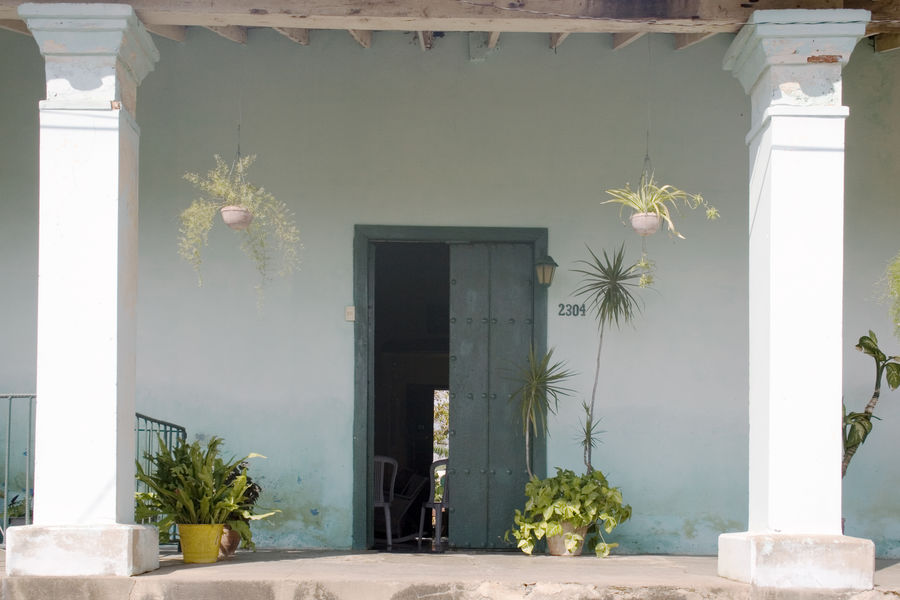 Cuba Cuba Collection Architecture Building Building Exterior Built Structure Day Decoration Door Entrance Flower Flowering Plant Growth House Houseplant Nature No People Outdoors Plant Potted Plant Wall - Building Feature Window