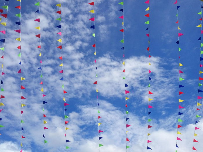 Colorful flags against sky