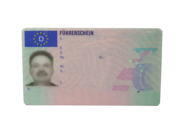 Driving license identity card isolated. Plastic ticket of flat driver license in Germany White Background Studio Shot Finance Business Communication Paper Indoors  No People Close-up Currency Cut Out Text Western Script Document Single Object Copy Space Paper Currency Technology Wealth #NotYourCliche Love Letter Humanity Meets Technology