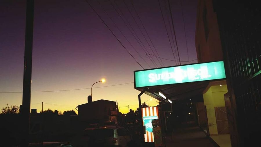 Yendo Cielo EyeEmNewHere Afternoon VSCO Trelew Chubut Argentina Argentina Photography Purple Yellow City Illuminated Sunset Road Sign Silhouette Dusk Sky Architecture Building Exterior Built Structure Neon Traffic Light  Traffic Signal Neon Colored Store Sign