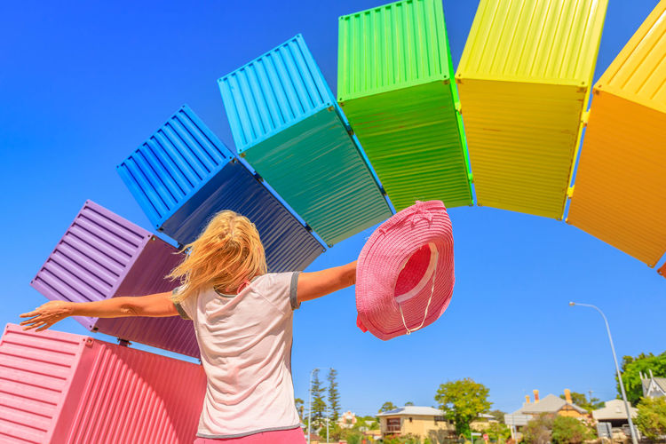 Happy woman with open arms looking Rainbow Sea Container in Fremantle, Western Australia. Female tourist enjoys at Fremantle welcome. Homosexuality and hope concept Freemantle Perth Perth Australia Western Australia Australia Australian Rainbow Bridge Colorful Rainbow Colors Rainbow🌈 Blue Sky Woman Homosexual Love Pink Color Girl Females Happy Happyness Sky Day Multi Colored Women Leisure Activity One Person Blue Real People Built Structure Architecture Lifestyles Building Exterior Adult Rear View Nature Hair Three Quarter Length Sunlight Blond Hair Hairstyle Outdoors Human Arm