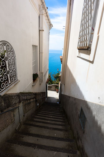 Architecture Blue Building Exterior Built Structure Day Footpath Leading Outdoors Positano Railing Residential Building Sea Sky Staircase Steps Steps And Staircases The Way Forward Wall - Building Feature