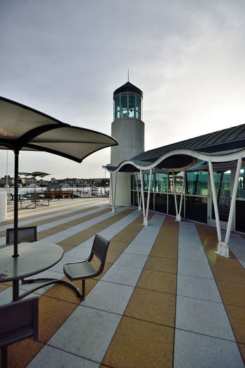 Observation Tower 4 Jack London Square Port Of Oakland,Ca. Waterfront♥ Marina Observation Tower Architecture Architectural Feature Lighthouse Striped Deck Awning Tinted Glass Umbrellas Tables & Chairs Harbor Lookout Benches Reflections In The Windows Masts Lamposts Sky Built Structure Architectural Detail