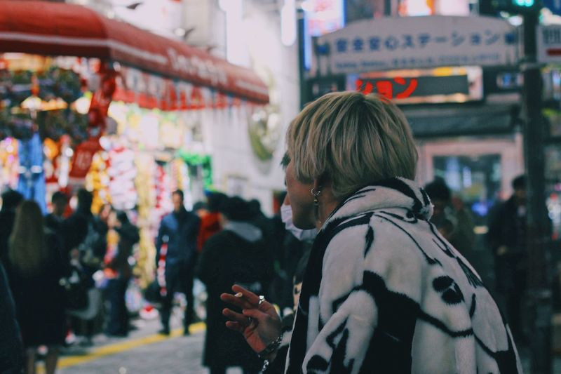 Tokyo street at night! Beautiful Landmark Photography Street Japan Tokyo Streetphotography Menswear Mensfashion Men City Real People Rear View Focus On Foreground One Person Street Redefining Menswear Lifestyles Incidental People Architecture Adult Leisure Activity Built Structure City Life Waist Up City Street Portrait Hairstyle