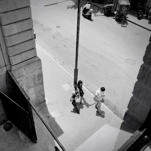 The Street Photographer - 2017 EyeEm Awards Real People High Angle View Men Day Two People Occupation Outdoors Manual Worker Full Length Lifestyles Working Reflective Clothing Architecture Hardhat  Only Men Adult People Streetphotography Street Photography Streetphoto_bw Blackandwhite Black And White Black & White Blackandwhite Photography
