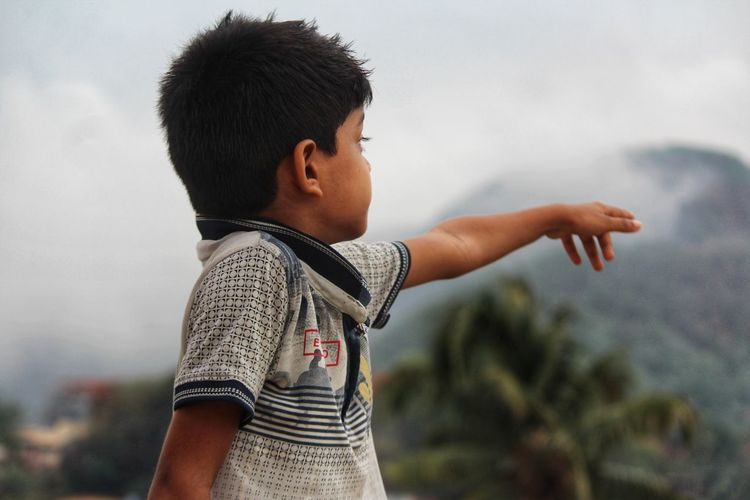 Side view of boy showing the beauty of nature