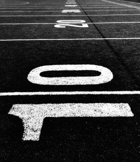 10 years. It's just a beginning. 10 10 Year Anniverary  American Football Field Close-up Communication Competition Day High Angle View Marking No People Number Outdoors Sport White Color Yard Line - Sport