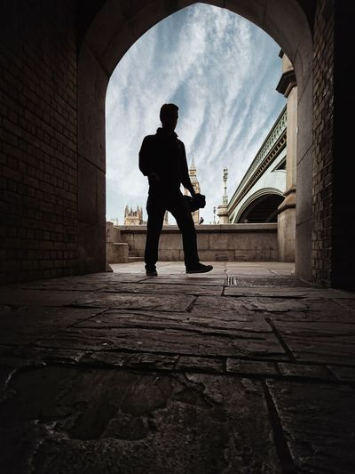 Rear view of silhouette man standing in city