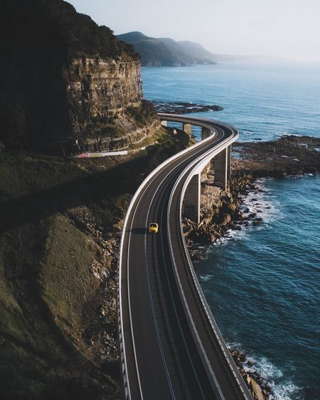 @itchban / itchban.com Drone  High Angle High Angle View Land Mode Of Transportation Mountain Mountain Road Nature Outdoors Road Rock Rock Formation Sea Sky Transportation Water The Traveler - 2018 EyeEm Awards