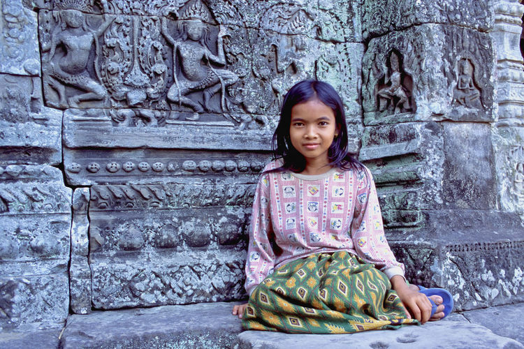 Angkor Wat Complex. Young local girl posing at the Bayon, Cambodia Angkor Wat Complex Architecture ASIA Beauty Cambodia Color Image Cultures Day Girl Horizontal Khmer Temple Local One Person Outdoors People Portrait Posing Real People Sari Siem Reap The Bayon Traditional Clothing UNESCO World Heritage Site
